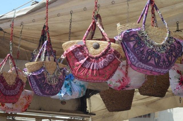 At the weekly market ...Italian purses
