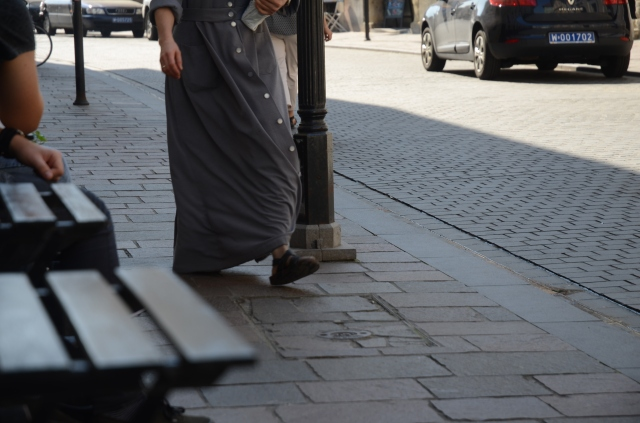 A rushing nun in her Birkenstock's