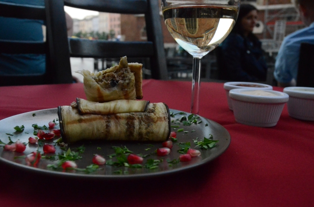 A dinner with Gregorian eggplant rolls filled with walnuts